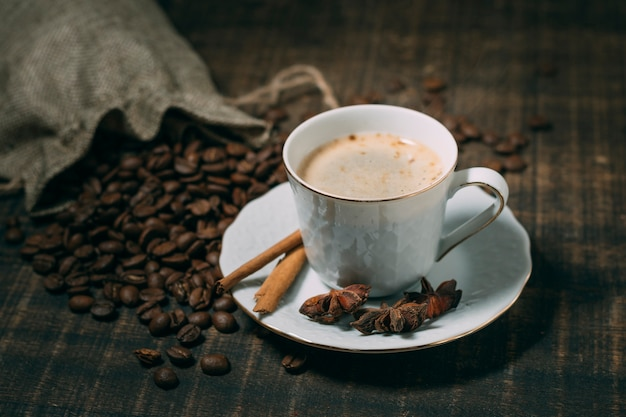 Close-up cup of coffee with star anise