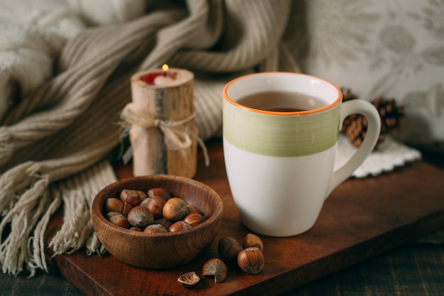 Close-up cup of tea with acorns