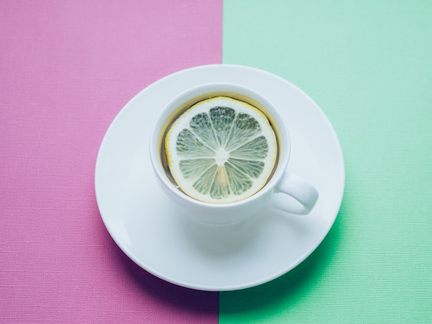 Close up of cup of tea with lemon