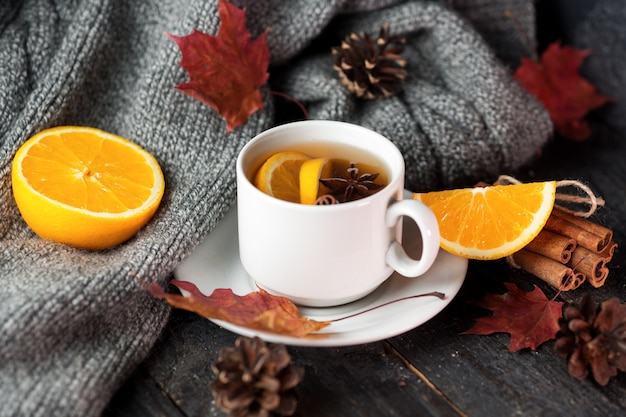 Close up of a cup of tea with orange and cinnamon