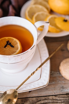 Close-up cup of tea with slices of lemon