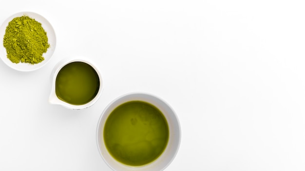 Close-up cups with matcha powder on the table