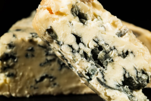 Close-up of cut blue cheese with mould inside