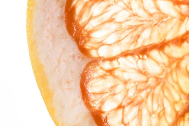 Close-up cut slice of ripe grapefruit