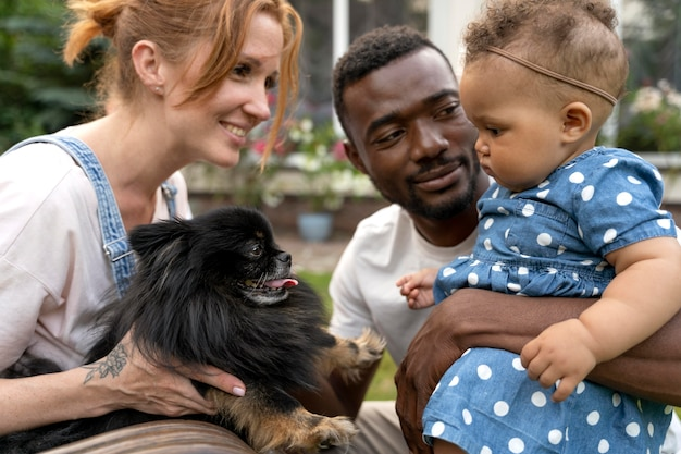 Close up cute family with dog