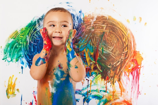 Close-up of cute kid full of paint