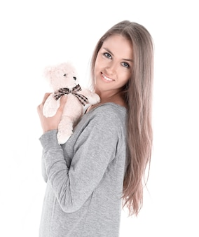 Крупным планом. милая молодая женщина с любимой мягкой игрушкой. изолированные на белом фоне