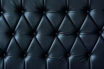 Close-up dark blue sofa leather texture for background