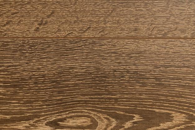 Close-up of dark brown laminate floor covering