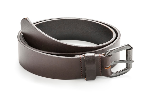 Close-up of dark brown leather belt strap curled up on a white background. isolated with clipping path photo.
