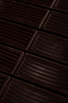 Close up of dark chocolate bar tiles