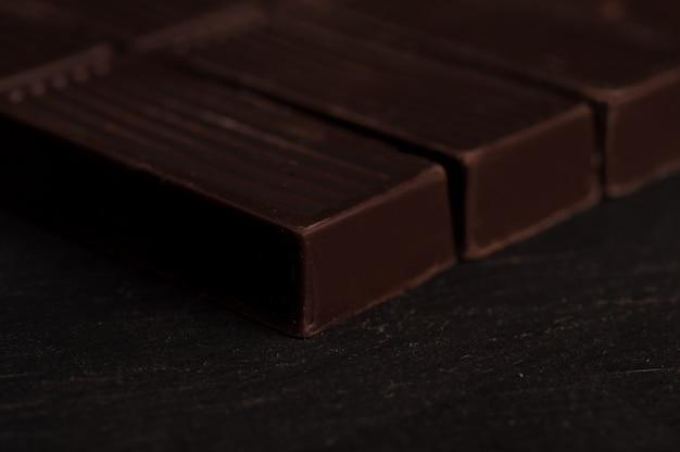 Close up of dark chocolate bar tiles