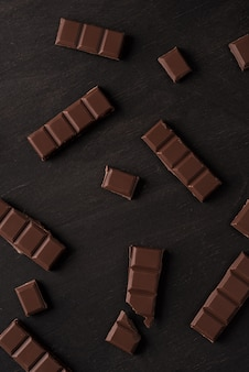 Close-up of dark chocolate bar tiles