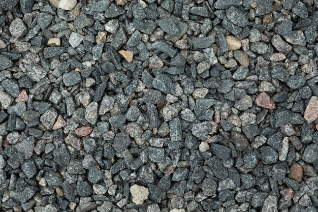 Close-up of dark gray gravel lying on ground