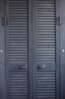 Close up of dark gray shutter doors