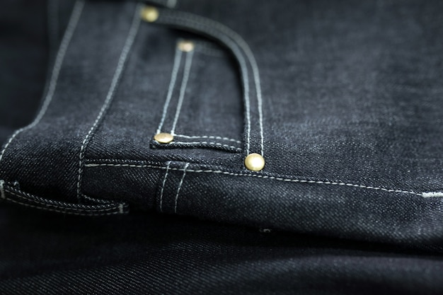 Close-up of dark jeans