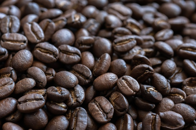 Close up dark roast coffee beans roasted coffee beans background texture