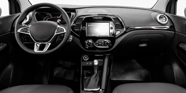 Close-up of the dashboard, player, steering wheel, accelerator handle, buttons, seats.