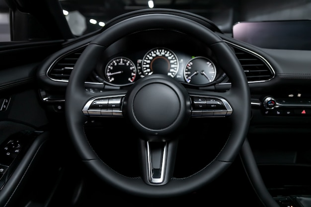 Close-up of the dashboard, player, steering wheel, buttons. modern car interior: parts, buttons, knobs