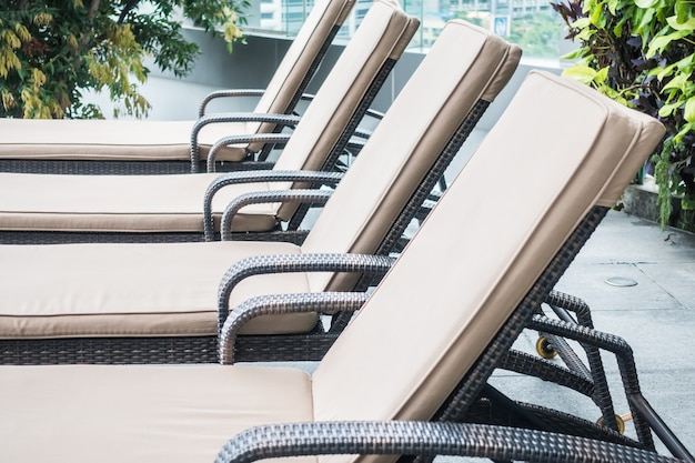 Close-up of deck chairs in row