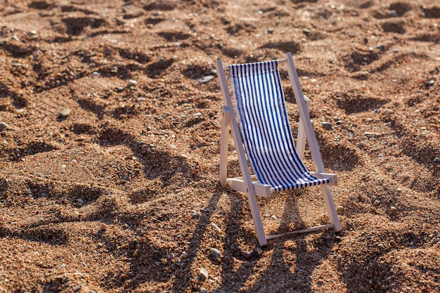 Close-up of a decorative deck chair standing on the sand. montenegro sea beach. montenegro