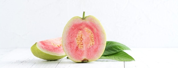 Close up of delicious beautiful red guava with fresh green leaves