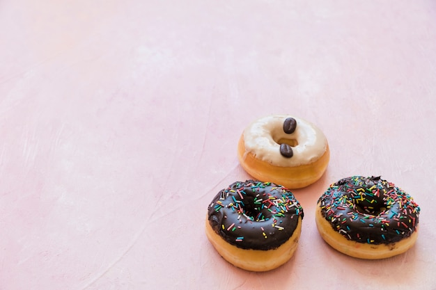 Close-up of delicious donuts on pink background