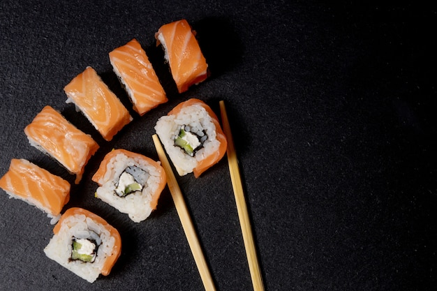 Close up delicious japanese food sushi over dark background