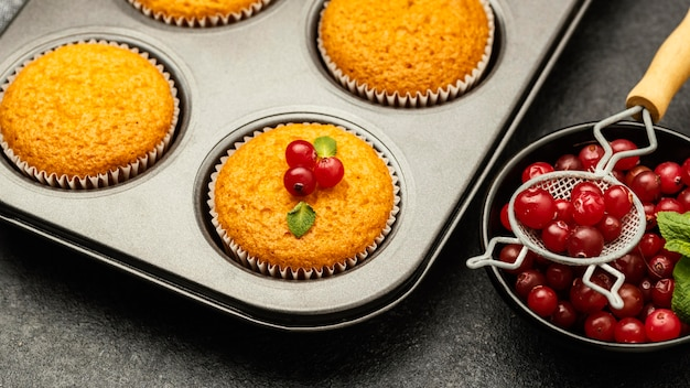 Close-up of delicious muffins with berries in pan