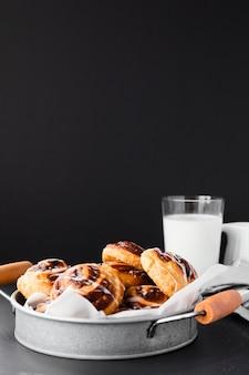 Close-up delicious pain aux raisin and milk