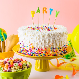 Close-up of delicious party cake with bowl of froot loop