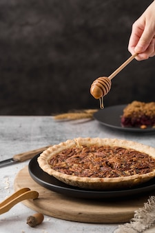 Close-up delicious pecan pie ready to be served