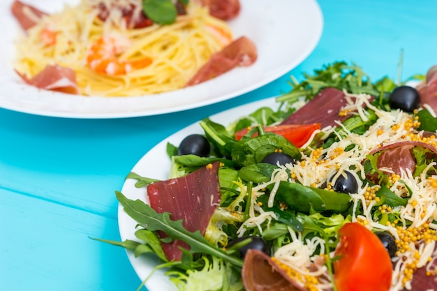 Close up of delicious salad with dried meat
