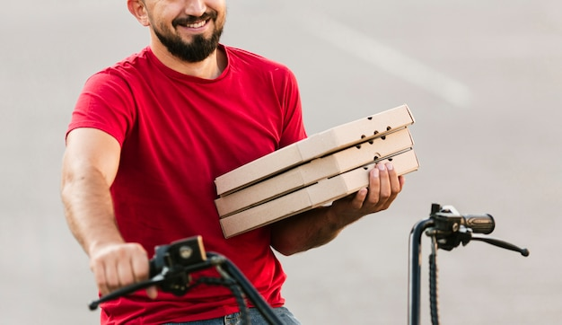 Close-up delivery guy on motorcycle