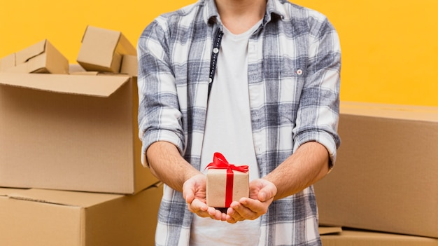 Close-up delivery man holding small package