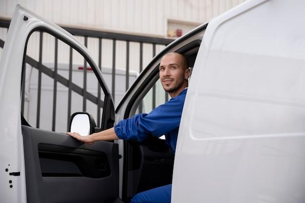 Close up delivery man in van