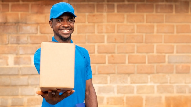 Close up on delivery person with parcel