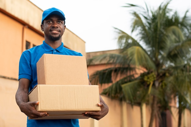 Close up on delivery person with parcels