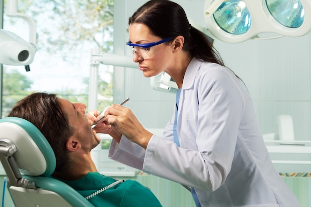 Close-up of a dentist working on patient
