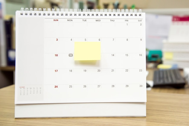 Close-up desk calendar and note paper.