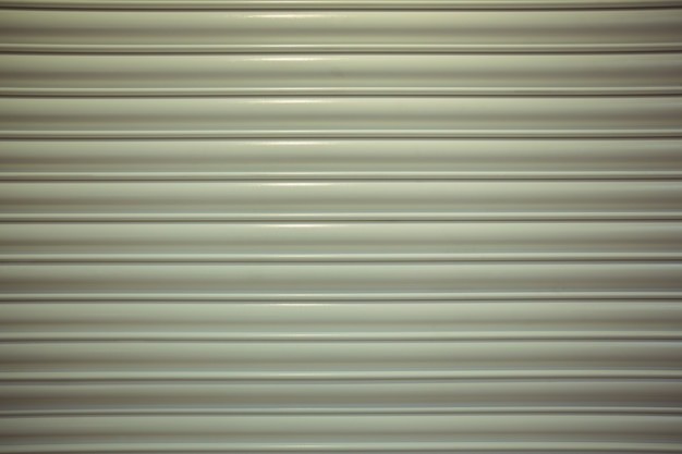 Close-up detail of closed metal security shutter