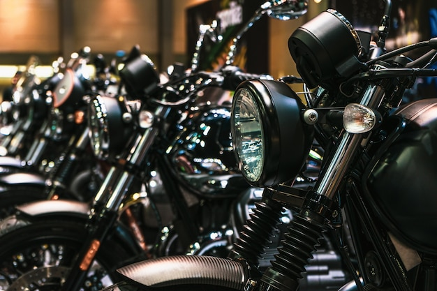 Close up detail of headlights and chrome parts of motorbikes