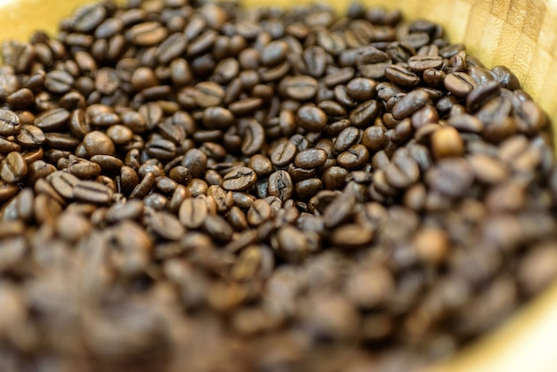 Close-up in detail of roasted colombian coffee beans.