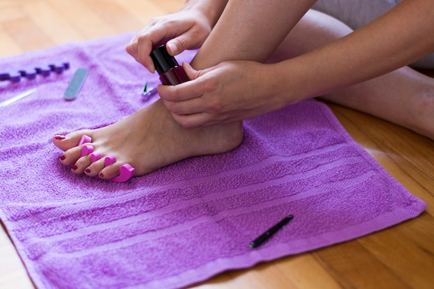 Close up details of a female feet on pedicure procedure