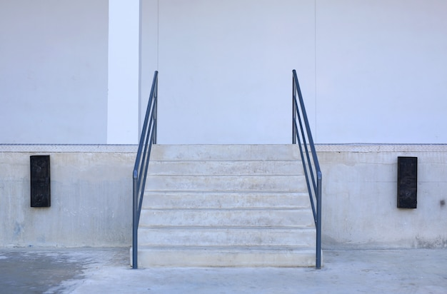 Close-up details of stairs and railing of a building.