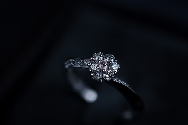 Close up of diamond ring on dark background