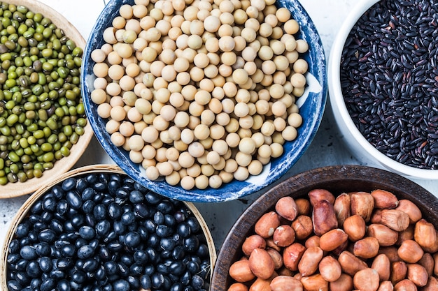 Close-up of different legumes in bowls