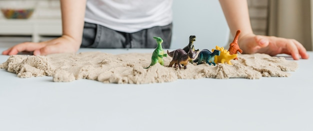 Close-up dinosaurs on sand