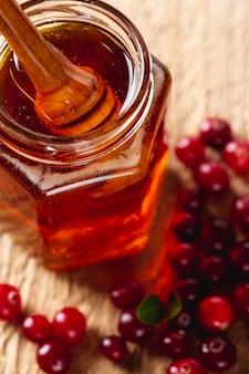 Close up dipper in honey jar