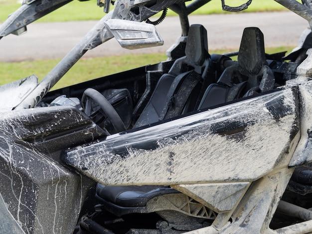 Close-up. dirty cockpit atv utv buggy.